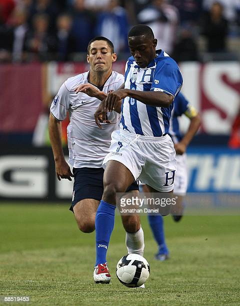 Maynor Figueroa of Honduras moves upfield with the ball as Clint Dempsey of the United States pursues during a FIFA 2010 World Cup Qualifying match...