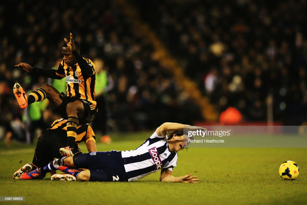Maynor Figueroa of Hull City and Billy Jones of West Bromwich Albion challenge for the ball during the Barclays Premier League match between West Bromwich Albion and Hull City at The Hawthorns on December 21, 2013 in West Bromwich, England.