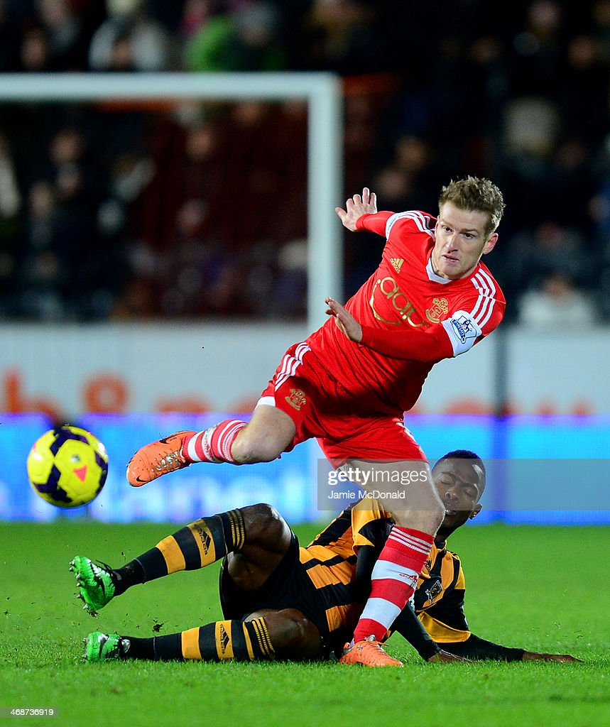 Maynor Figueroa of Hull City tackles Steven Davis of Southampton during the Barclays Premier League match between Hull City and Southampton at the KC Stadium on February 11, 2014 in Hull, England.