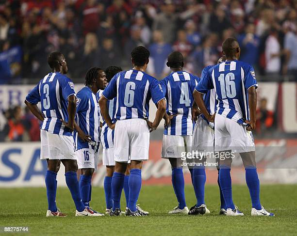 Maynor Figueroa Walter Martinez Mario Beata Hendry Thomas and Georgie Welcome of Honduras watch as members of the United States celebrate a win...