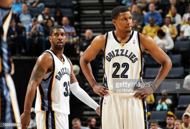J Mayo and Rudy Gay of the Memphis Grizzlies stand on the court during the game against the Dallas Mavericks at the FedExForum on March 31 2010 in...