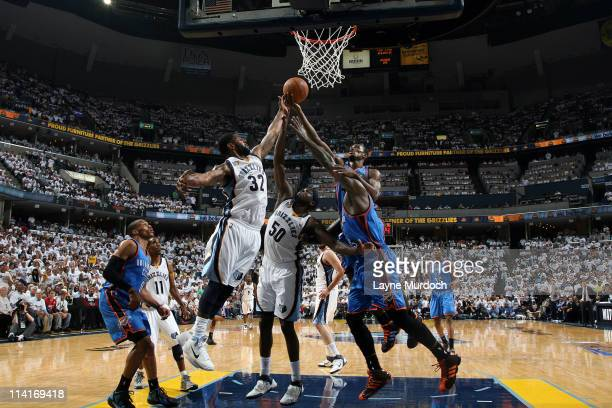 J Mayo and Zach Randolph of the Memphis Grizzlies battles for the loose ball with Serge Ibaka and Kendrick Perkins of the Oklahoma City Thunder...
