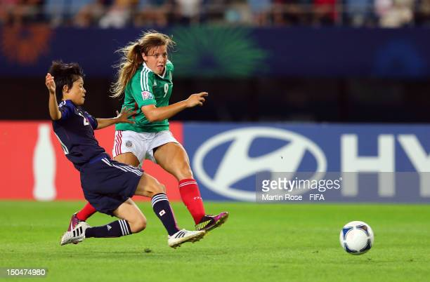 Mayo Doko of Japan and Sofia Huerta of Mexico battle for the ball during the FIFA U20 Women's World Cup 2012 group A match between Japan and Mexico...