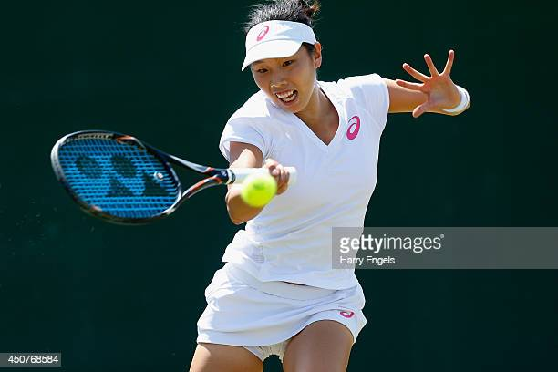 Mayo Hibi of Japan in action during her first round qualifying match against Allie Kiick of the USA on day two of the Wimbledon Championships 2014...