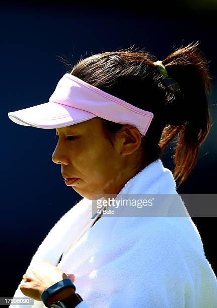 Mayo Hibi of Japan looks on during a break in the girls' singles semifinal match against Ana Konjuh of Croatia on Day Thirteen of the 2013 US Open at...