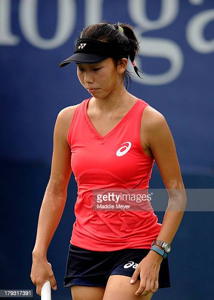 Mayo Hibi of Japan looks on during her girls' singles first round match against Sara Tomic of Australia on Day Seven of the 2013 US Open at USTA...