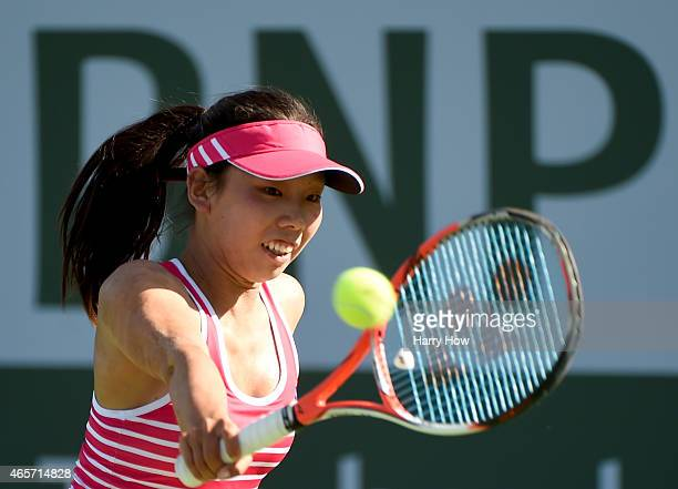 Mayo Hibi of Japan plays a backhand against Lesia Tsurenko of Ukraine during qualifying of the BNP Paribas Open tennis at the Indian Wells Tennis...