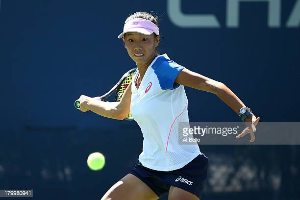 Mayo Hibi of Japan plays a forehand during the girls' singles semifinal match against Ana Konjuh of Croatia on Day Thirteen of the 2013 US Open at...