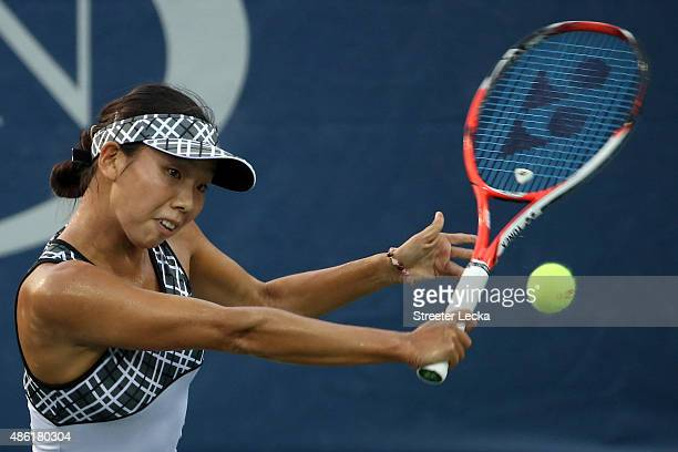 Mayo Hibi of Japan returns a shot to Sara Errani of Italy during their Women's Singles First Round match on Day Two of the 2015 US Open at the USTA...