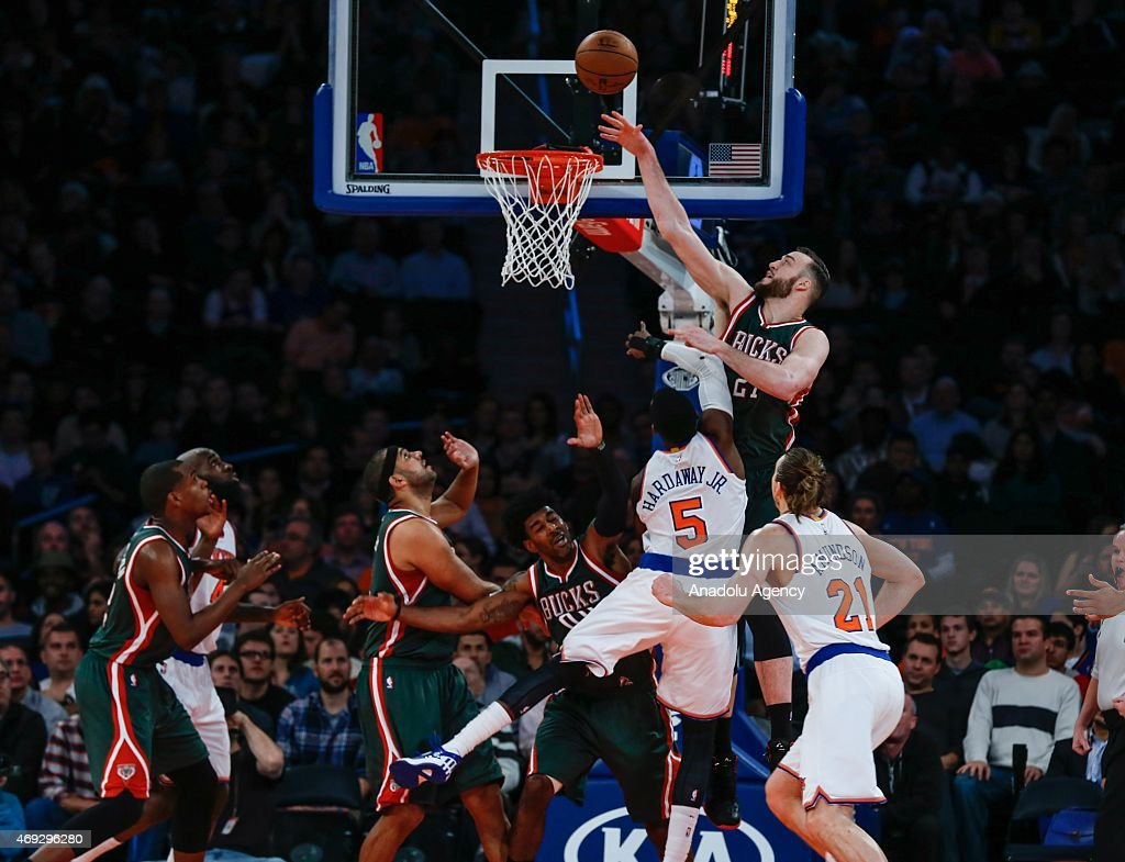 O.J. Mayo (C), Miles Plumlee #21 and Jared Dudley (3rd L) of the Milwaukee Bucks in action against Quincy Acy (2nd L), Tim Hardaway Jr. #5 and Lou Amundson #21 of the New York Knicks at Madison Square Garden on April 10, 2015 in New York, New York.