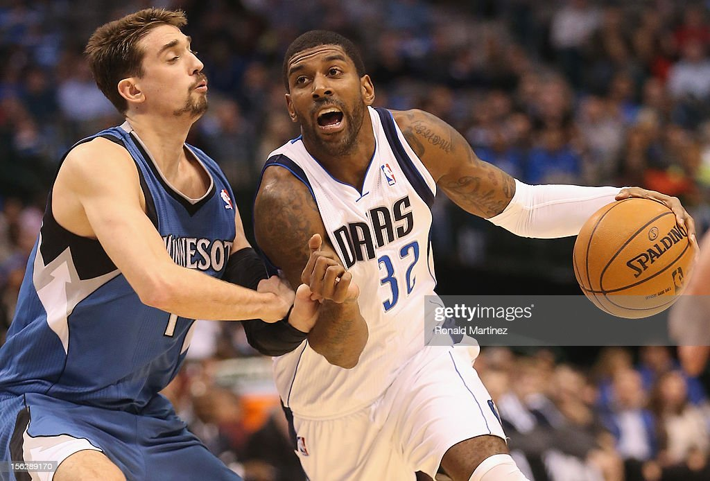 O.J. Mayo #32 of the Dallas Mavericks dribbles the ball against Alexey Shved #1 of the Minnesota Timberwolves at American Airlines Center on November 12, 2012 in Dallas, Texas.