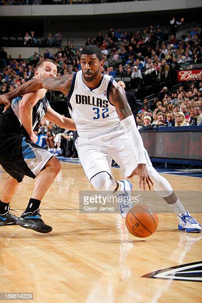 J Mayo of the Dallas Mavericks drives against JJ Barea of the Minnesota Timberwolves on January 14 2013 at the American Airlines Center in Dallas...