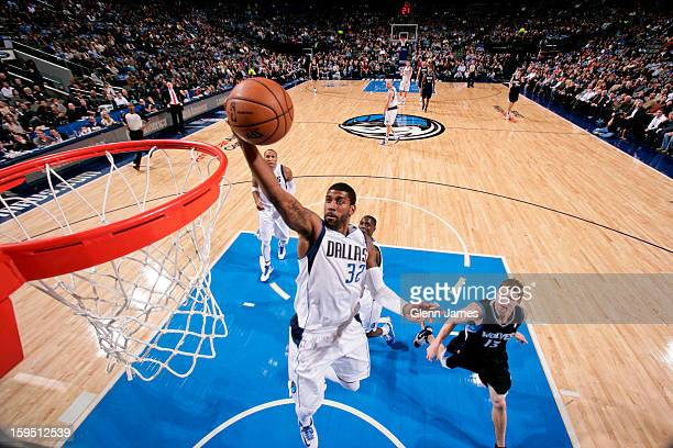 J Mayo of the Dallas Mavericks drives to the basket ahead of Luke Ridnour of the Minnesota Timberwolves on January 14 2013 at the American Airlines...