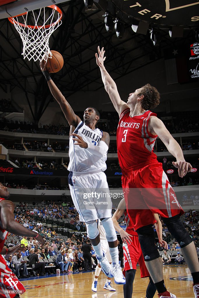 O.J. Mayo #32 of the Dallas Mavericks goes in for the layup against Omer Asik #3 of the Houston Rockets on October 15, 2012 at the American Airlines Center in Dallas, Texas.
