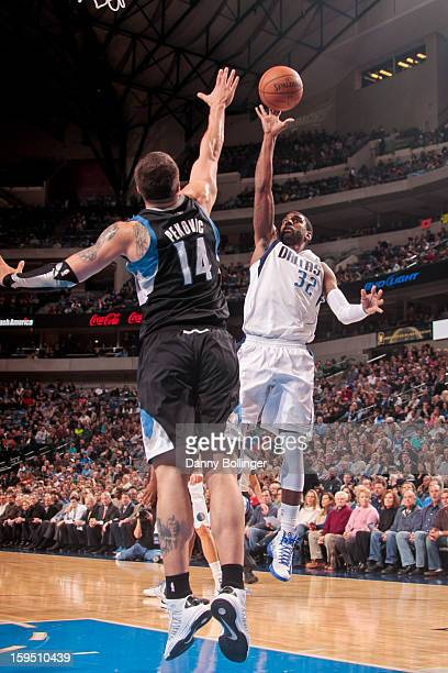 J Mayo of the Dallas Mavericks shoots a floater against Nikola Pekovic of the Minnesota Timberwolves on January 14 2013 at the American Airlines...