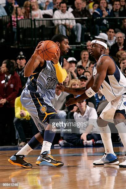 J Mayo of the Memphis Grizzlies drives the ball against Jason Terry of the Dallas Mavericks during the game on December 26 2009 at American Airlines...
