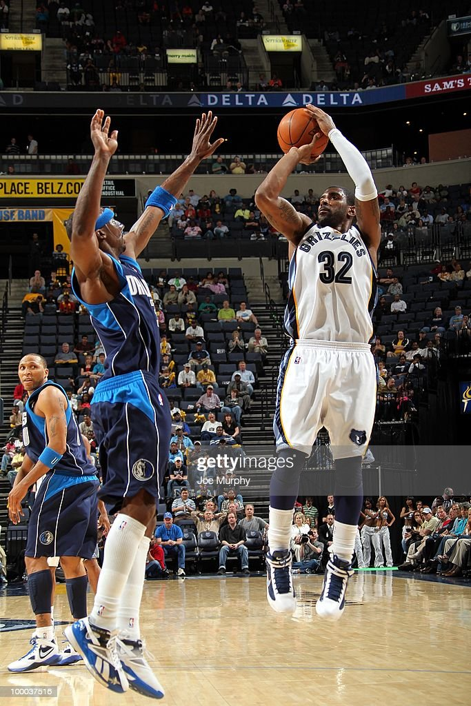O.J. Mayo #32 of the Memphis Grizzlies shoots a jump shot against Jason Terry #31 of the Dallas Mavericks during the game at the FedExForum on March 31, 2010 in Memphis, Tennessee. The Mavs won 106-102.