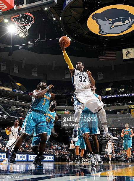 J Mayo of the Memphis Grizzlies shoots against Chris Paul of the New Orleans Hornets on October 18 2010 at the FedExForum in Memphis Tennessee NOTE...