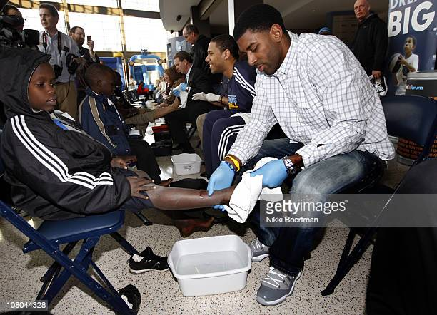 J Mayo of the Memphis Grizzlies washes feet during a Samaritan's feet event on January 14 2011 at FedExForum in Memphis Tennessee NOTE TO USER User...