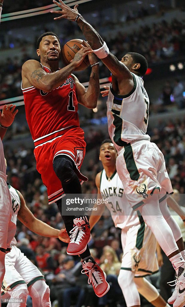O.J. Mayo #3 of the Milwaukee Bucks blocks a shot by Derrick Rose #1 of the Chicago Bulls at the United Center on March 7, 2016 in Chicago, Illinois. The Bulls defeated the Bucks 100-90.