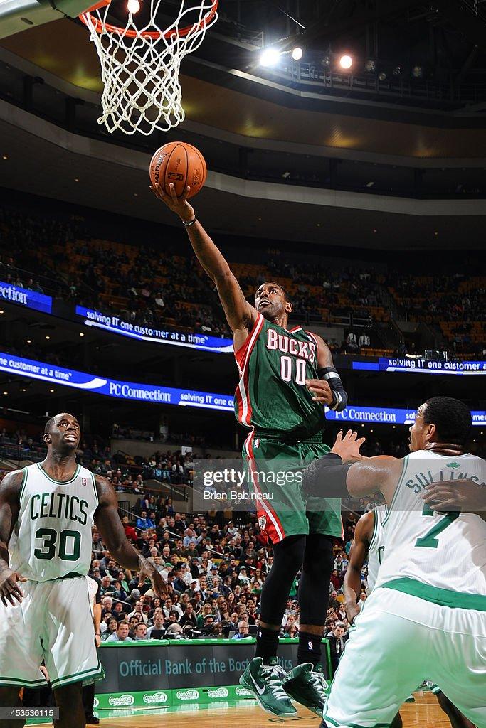 O.J. Mayo #00 of the Milwaukee Bucks drives to the basket against the Boston Celtics on December 3, 2013 at the TD Garden in Boston, Massachusetts.