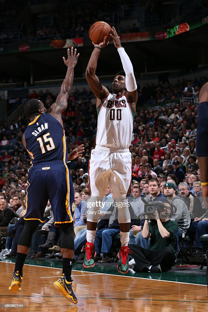 O.J. Mayo #00 of the Milwaukee Bucks shoots against Donald Sloan #15 of the Indiana Pacers on January 2, 2015 at the BMO Harris Bradley Center in Milwaukee, Wisconsin.
