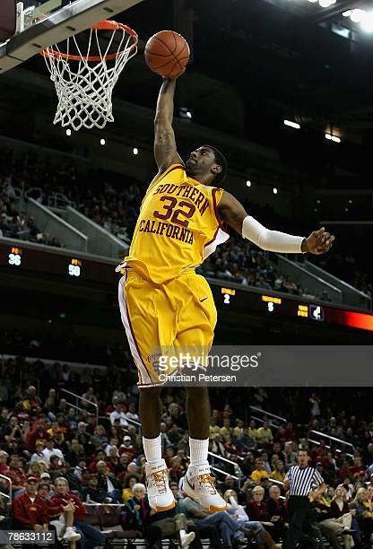 J Mayo of the USC Trojans slam dunks the ball during the game against the Cal Poly Mustangs at the Galen Center December 22 2007 in Los Angeles...