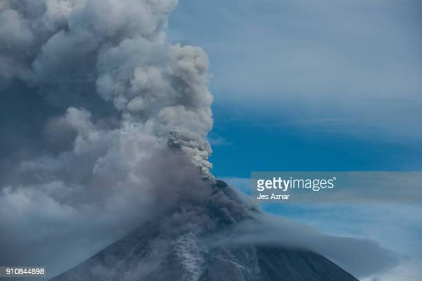 Mayon volcano is seen spewing ash on January 25 2018 in Albay Philippines Over 70000 villagers have been evacuated and camped in emergency shelters...