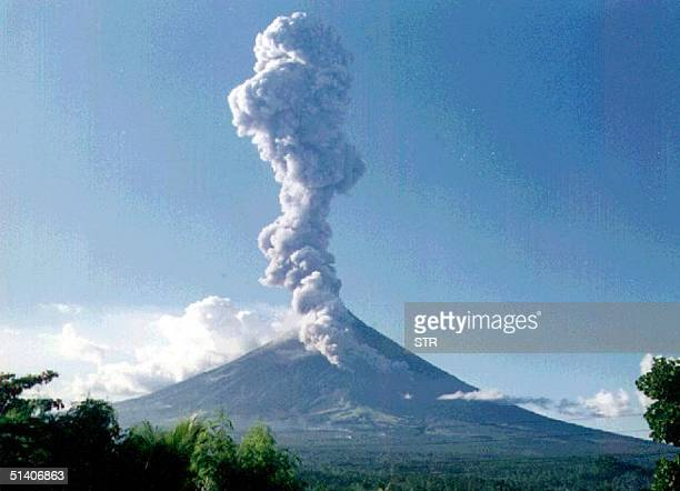 Mayon volcano seen from Daraga town erupts a column of ash and steam rising some 10kilometers 22 June 1999 sending scores of villagers fleeing from...
