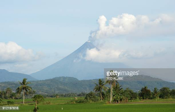 Mayon volcano spews ash as seen from Polangui town in Albay province south of Manila on January 30 2018 The threat of catastrophic mudflows is...