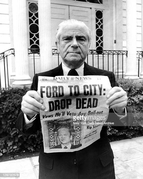 Mayor Abe Beame in front of Gracie Mansion holds famous New York Daily News front page headline 'FORD TO CITY DROP DEAD' and says 'This could never...
