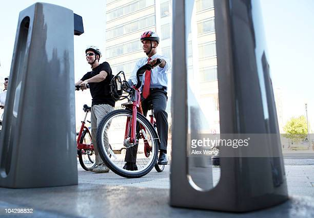 C Mayor Adrian Fenty about to checkin his bike at a station as he rides on a bike for a media photoop during the launching of the Capital Bikeshare...