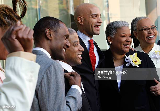 Mayor Adrian Fenty poses for photos with newly wed couples Rocky Galloway Reggie Stanley Candy Holmes and Darlene Garner after their weddings on the...