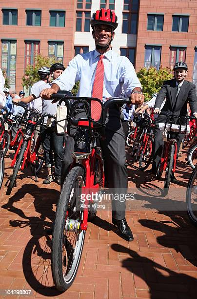 C Mayor Adrian Fenty rides on a bike for a media photoop during the launching of the Capital Bikeshare program September 20 2010 in Washington DC The...