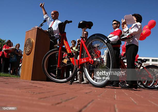 C Mayor Adrian Fenty speaks during the launching of the Capital Bikeshare program September 20 2010 in Washington DC The program the largest...