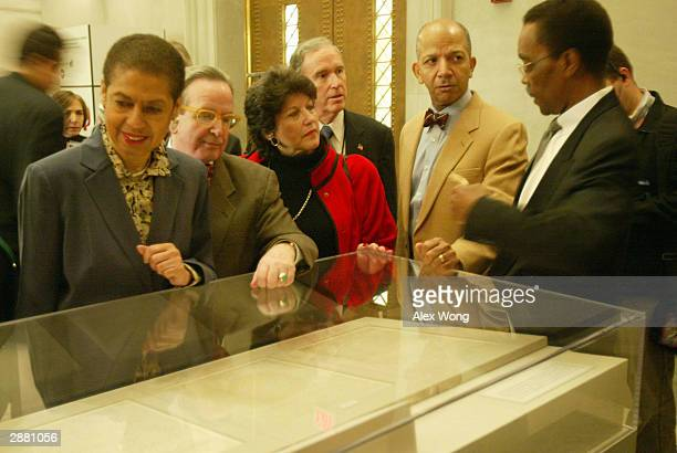 Mayor Anthony Williams Del Eleanor Holmes Norton and other city council members listen to African American history expert Dr Walter Hill's...