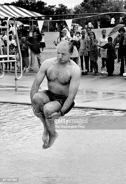 DC Mayor Anthony Williams just before he hit the water as he performed his signature 'cannon ball dive' at the KenilworthParkside Park pool to kick...