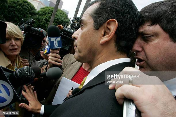 Mayor Antonio Villaraigosa holds back the media while LAUSD school board member David Tokofsky talks in his ear during the student protest over...