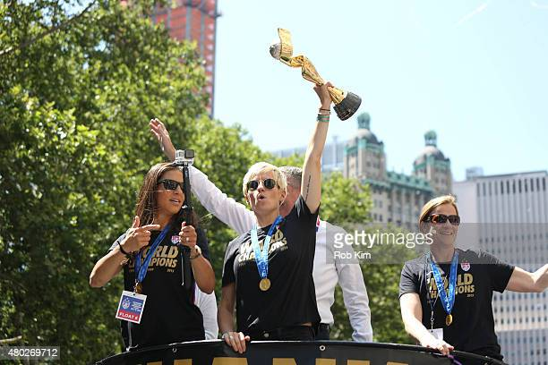 Mayor Bill de Blasio and wife Chirlane McCray ride a float with soccer players Carli Lloyd Megan Rapinoe holding trophy and head coach Jill Ellis...