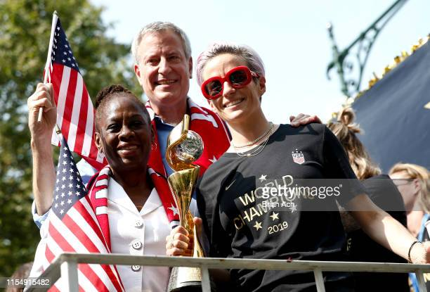 Mayor Bill de Blasio his wife Chirlane McCray and USWNT member and Golden Boot winner Megan Rapinoe celebrate while riding a float during the US...