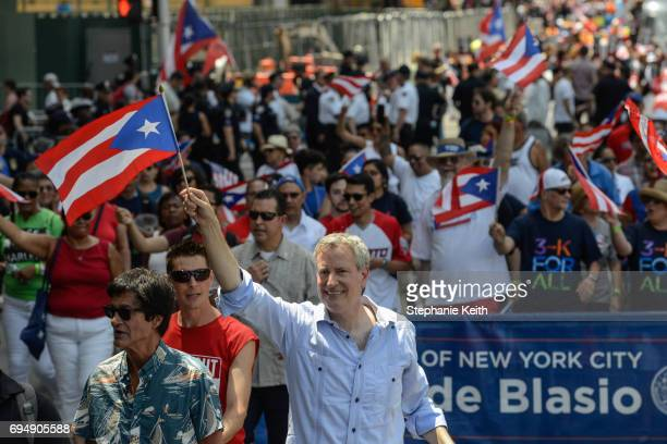 Mayor Bill de Blasio participates in the annual Puerto Rican Day Parade marching up 5th Ave on June 11 2017 in New York City Tensions were heightened...
