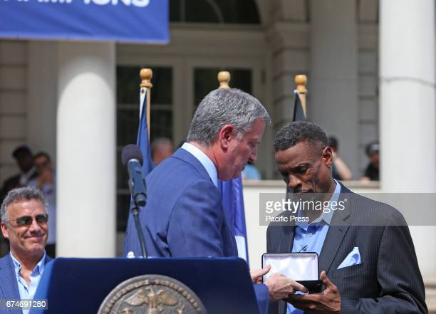 Mayor Bill de Blasio presents award to Dwight 'Doc' Gooden on the steps of NYC City Hall to honor Cy Young Award winner key player in the Mets's 1986...