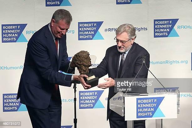 Mayor Bill de Blasio presents Robert De Niro with a 2014 Robert F Kennedy Ripple Of Hope Award at New York Hilton on December 16 2014 in New York City