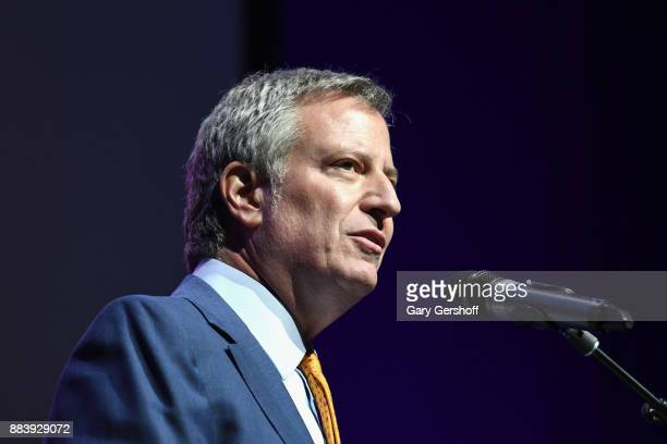 Mayor Bill de Blasio speaks on stage at World AIDS Day 2017 at Kings Theatre on December 1 2017 in the Brooklyn borough of New York City New York