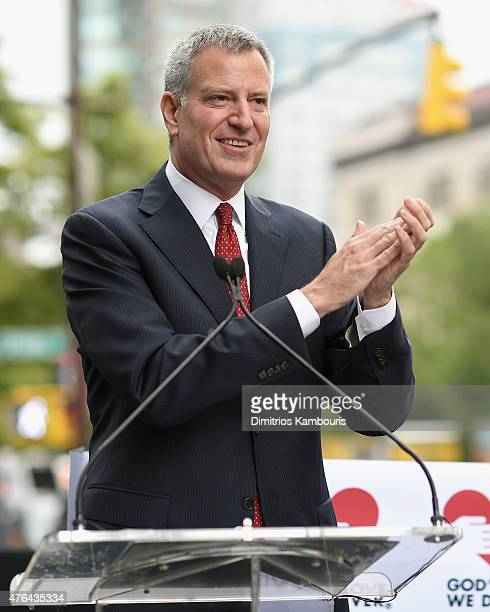 Mayor Bill de Blasio speaks onstage during the celebration of God's Love We Deliver returning to Soho with a dedication of the new Michael Kors...