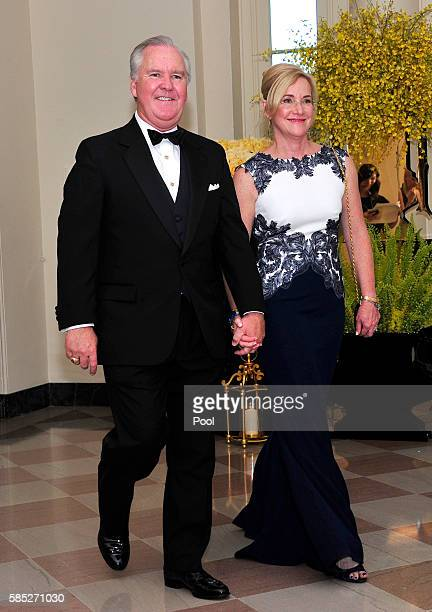 Mayor Bob Buckhorn of Tampa Florida and Dr Catherine Marie Buckhorn arrive at the White House August 2 2016 in Washington DC President Barack Obama...