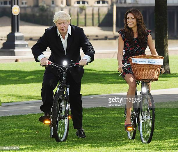 Mayor Boris Johnson and Kelly Brook attend a photocall to launch the Mayor of London's Sky Ride at Potters Field Park on August 31 2010 in London...