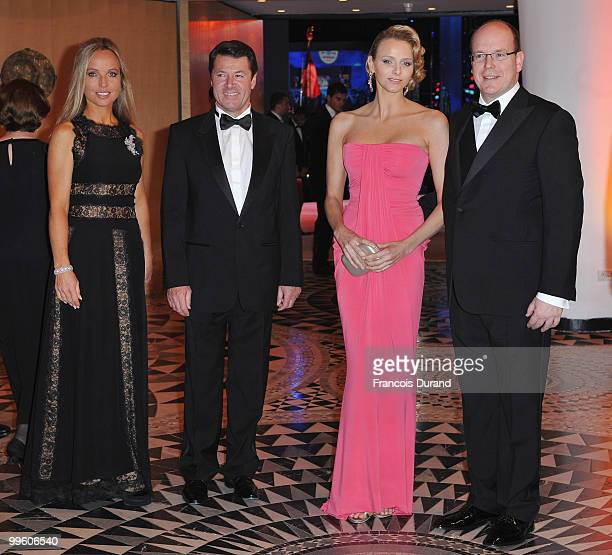 Mayor Christian Estrosi of Nice Charlene Wittstock and Prince Albert II of Monaco arrive at the Monaco Formula One Grand Prix dinner at the Monte...