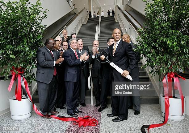 Mayor Corey Booker Gorvernor John Corzine and Devils owner Jeff Vanderbeek celebrate after cutting the ribbon for Prudential Center on October 25...