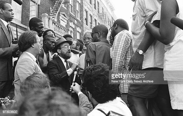 Mayor David Dinkins looks on while a Hasidic Jew and a black man argue during riots in Crown Heights Rioting erupted after two black 7yearolds Gavin...